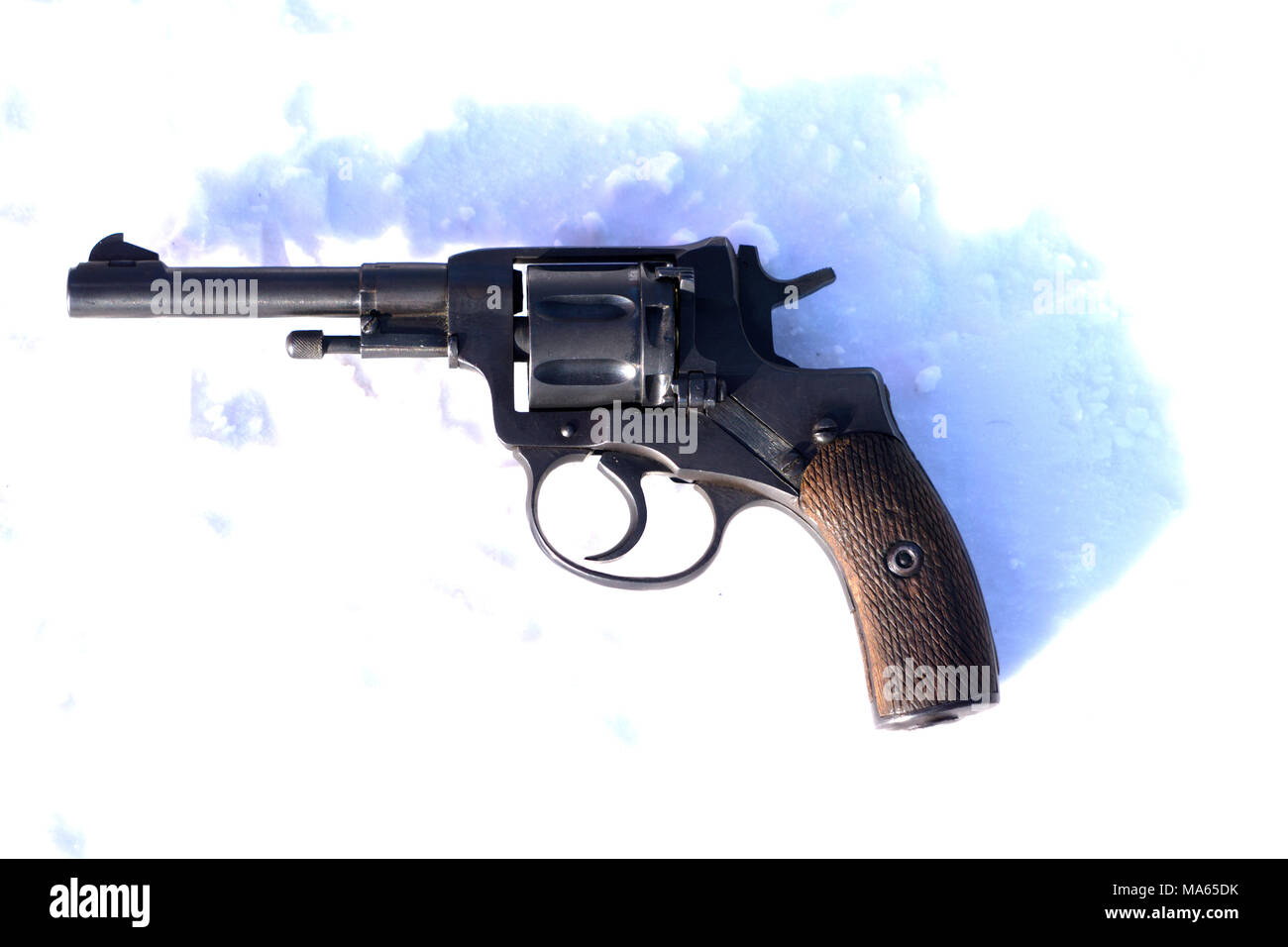 Mini Revolver with wooden grip on the blacket of snow - Stock Image