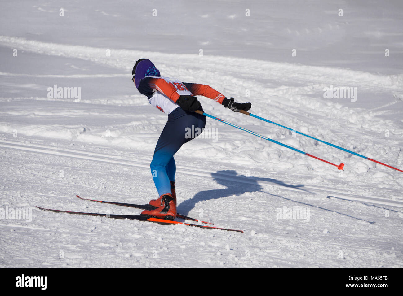 group of male skiers going uphill front view during Championship on cross country skiing . - Stock Image