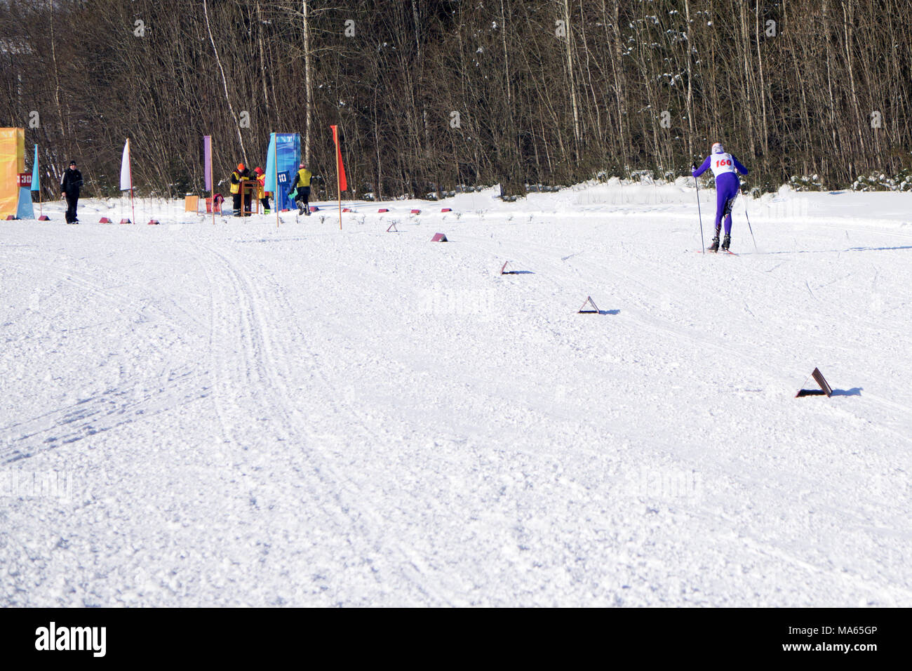Kind of centimeters, championship in of female relay race in cold conditions Unidentified competitors - Stock Image