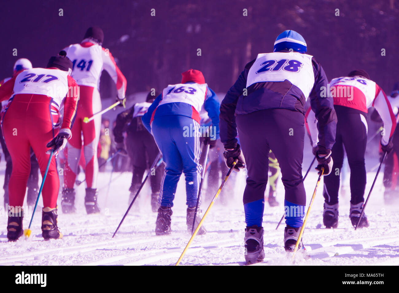 People skiing competitions at the beginning of the ski slope at the ski resort . - Stock Image