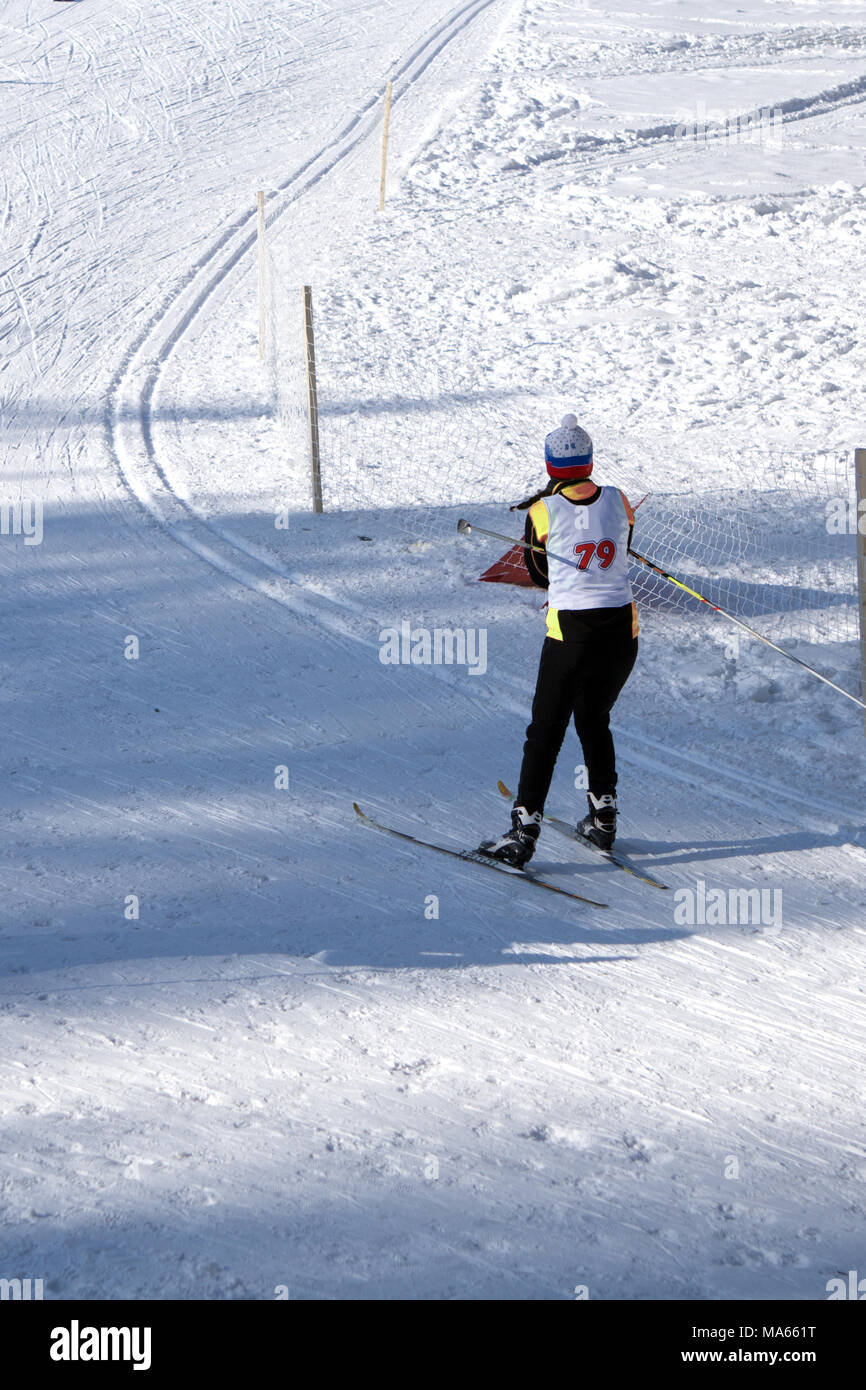 Skiers compete at the mass start in the men's 20km Skiathlon at the winter Olympics Stock Photo