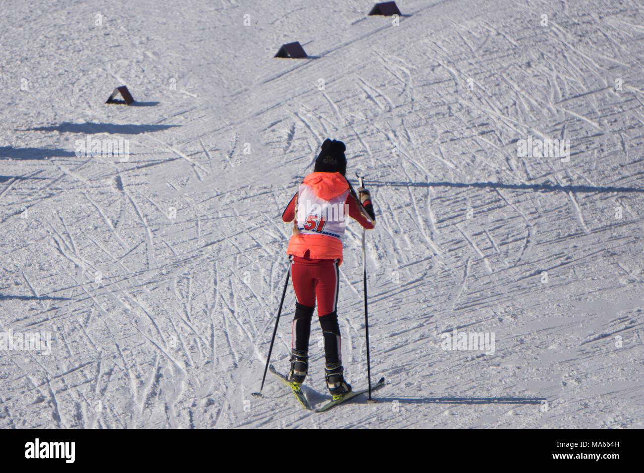 Competitions in downhill skiing among juniors are held annually on snow-covered slopes of the ski resort Gorki Gorod . Children skiers are going to st - Stock Image
