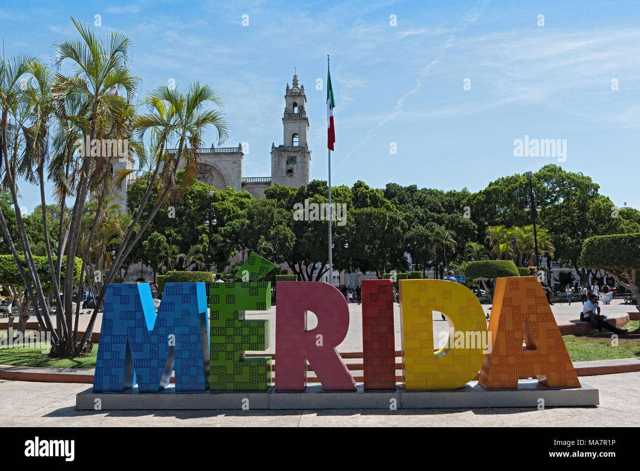 Colored lettering of the Mexican city Merida with mexican flag and cathedral - Stock Image