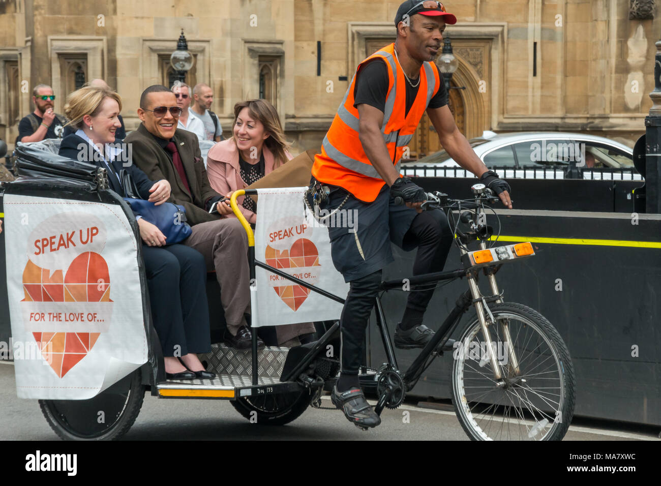 Two of the new intake of MPs, Mhairi Black SNP Paisley and Renfrewshire South and  Labour MP for Norwich South Clive Lewis share a rcycle rickshaw at the Climate Change Coalition Day of Action. Stock Photo
