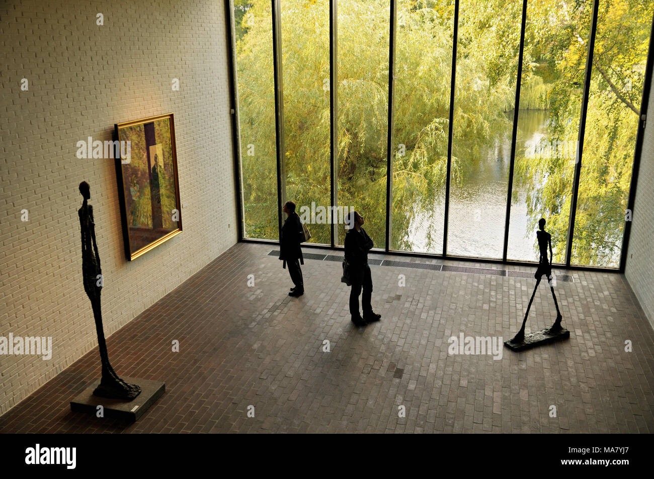 Visitors and sculptures from Alberto Giacometti at Louisiana Museum of Modern Art, Humlebæk, Denmark - Stock Image