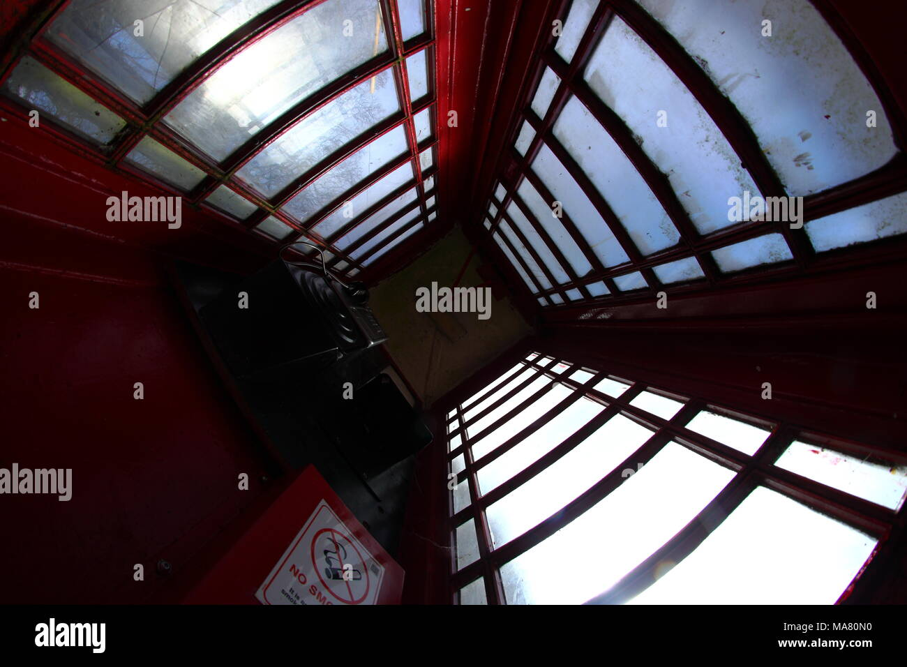 UK Red Telephone Box from the inside looking up - Stock Image