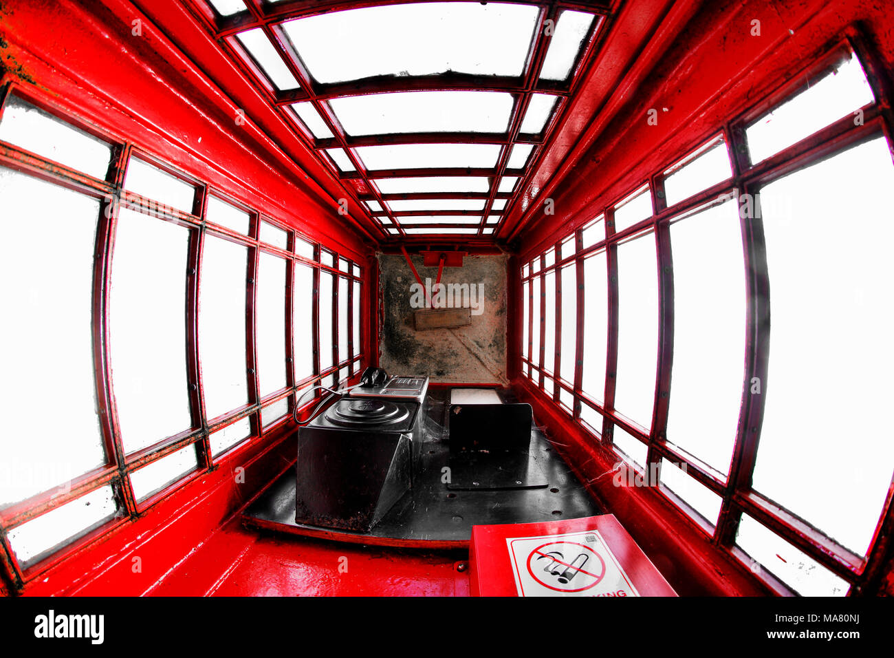 Looking up from ground level inside a Red Uk Telephone Box - Stock Image