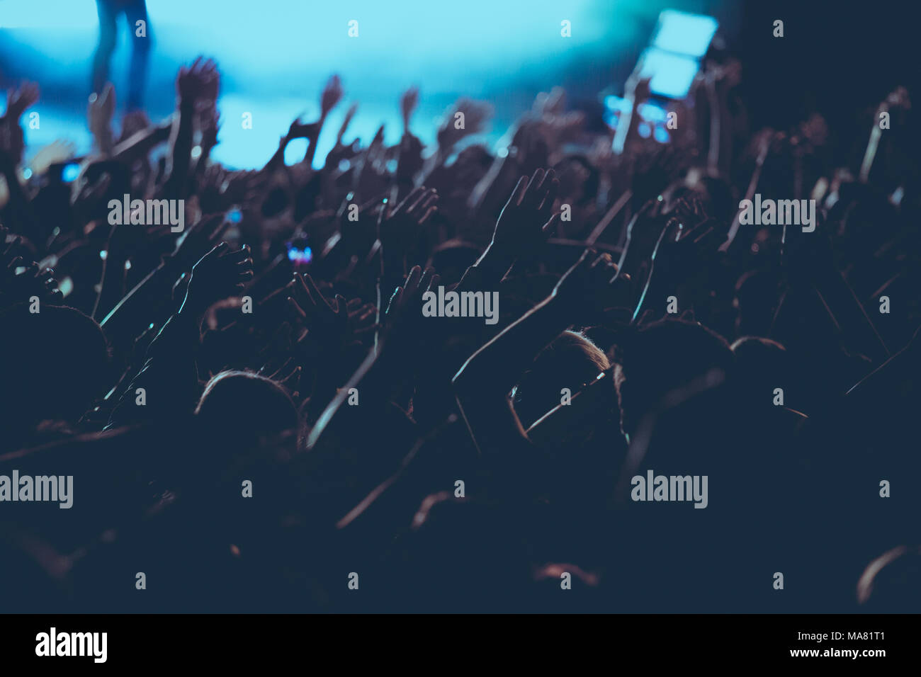 Silhouette of crowd in live concert. - Stock Image