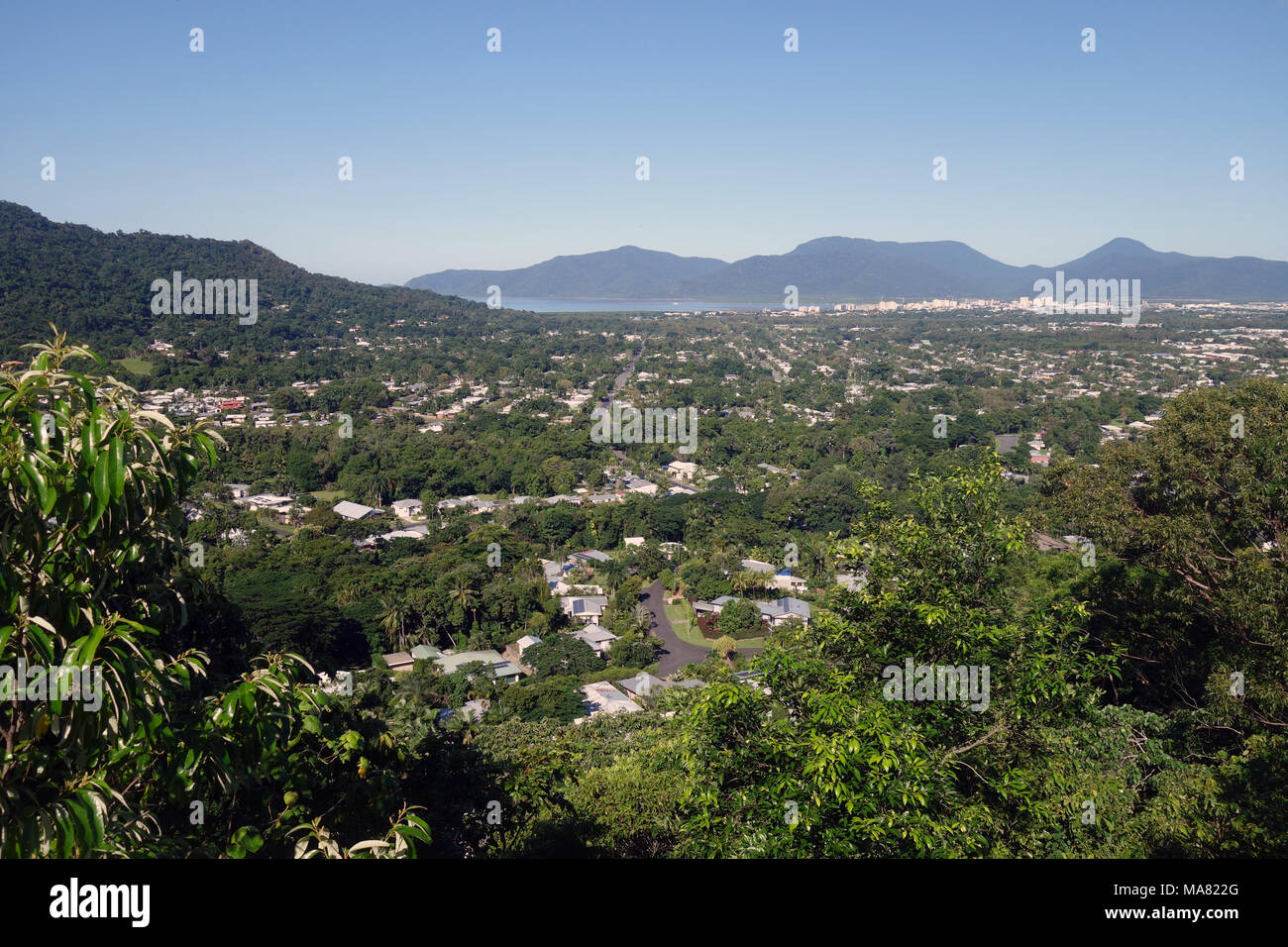View over leafy suburbs and city from Green Arrow walking track up Mt Whitfield, Cairns, Queensland, Australia. No PR - Stock Image