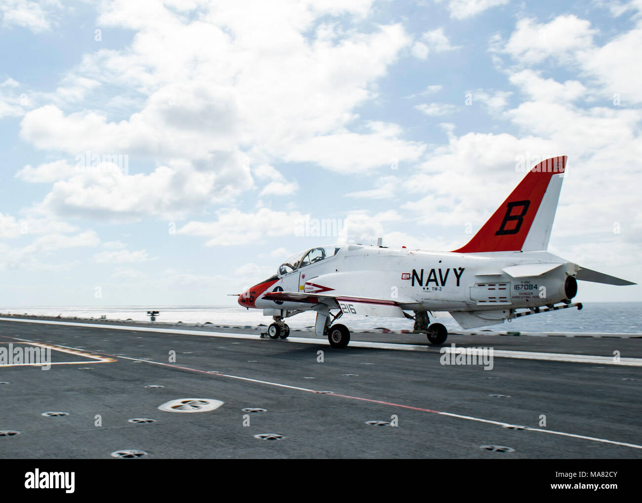 180328-N-WX604-0367 ATLANTIC OCEAN (March 29, 2018) Lt. j.g. Tyler Ballard, assigned to Training Air Wing (TW) 2, takes off in a T-45C Goshawk aboard the aircraft carrier USS George H.W. Bush (CVN 77). The ship is underway conducting sustainment exercises to maintain carrier readiness. (U.S. Navy photo by Mass Communication Specialist 2nd Class Joseph E. Montemarano) - Stock Image