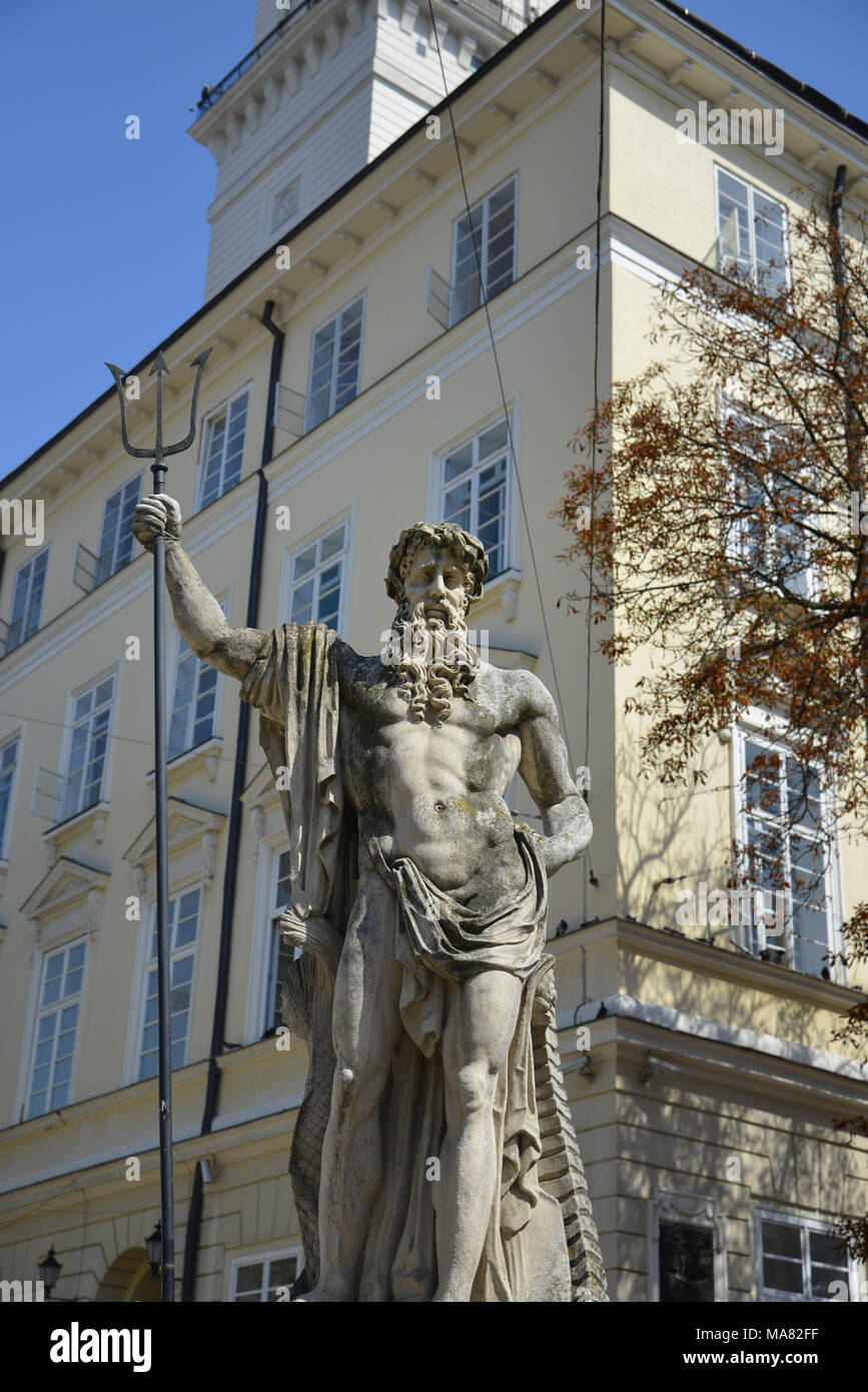 Statue of God Neptun in front of the town hall of Lviv in Ukraine. - Stock Image