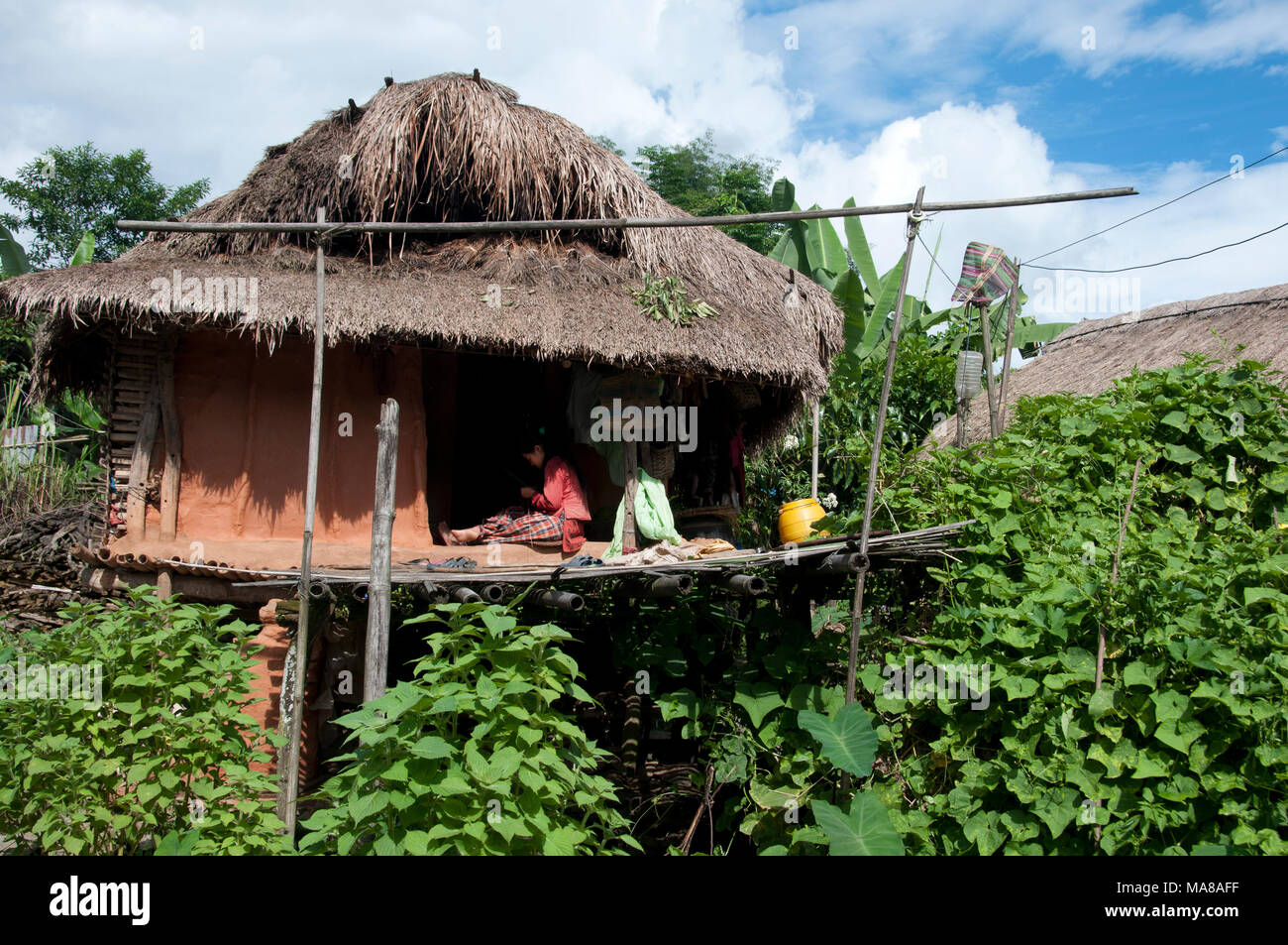 Women Sitting On The Bamboo Terrace Of A Traditional House Made From Wood  And Mud (wattle And Daub Stock Photo: 178434131   Alamy