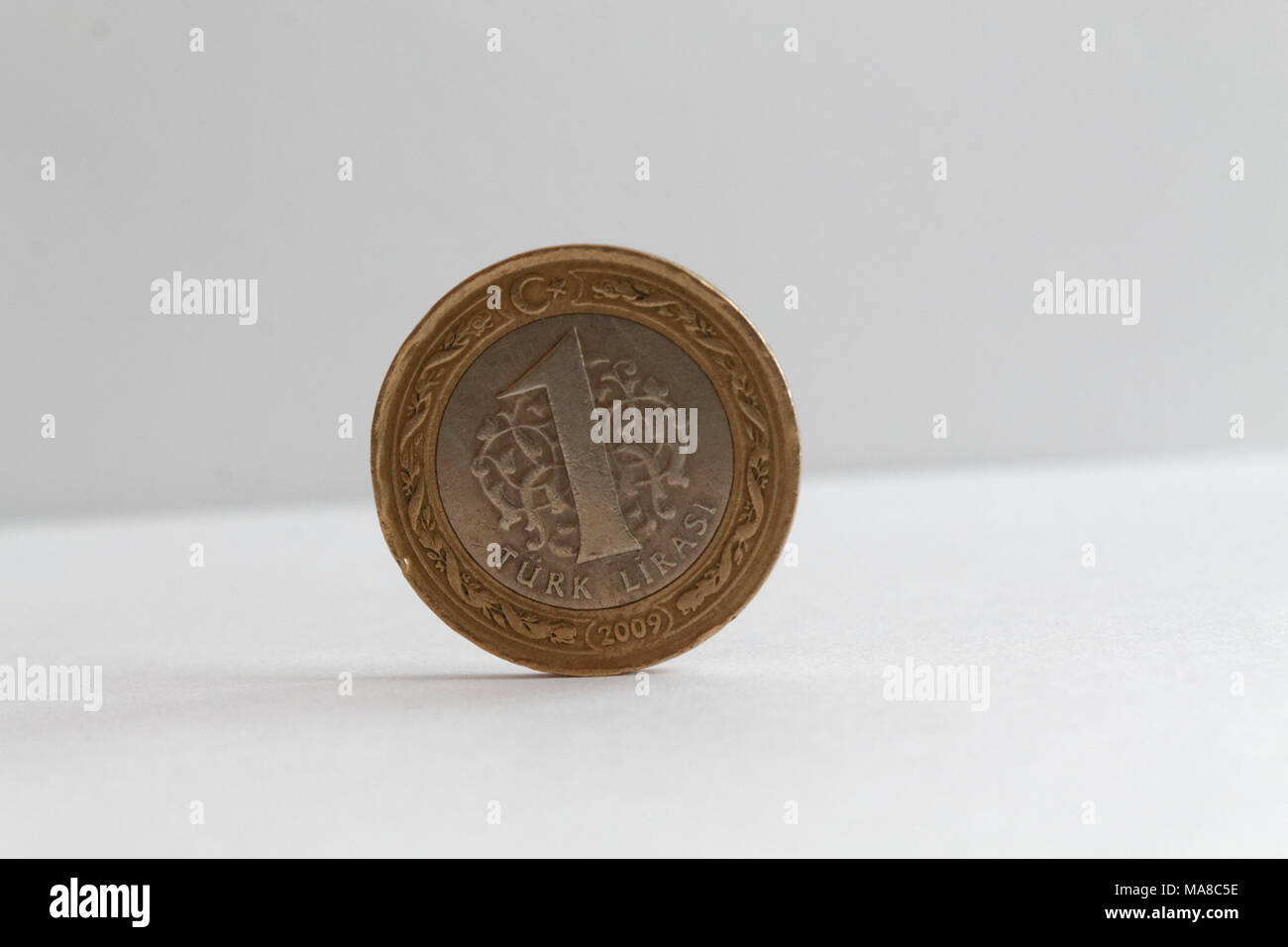 Turkish coin lie on isolated white background Denomination is one lira Stock Photo