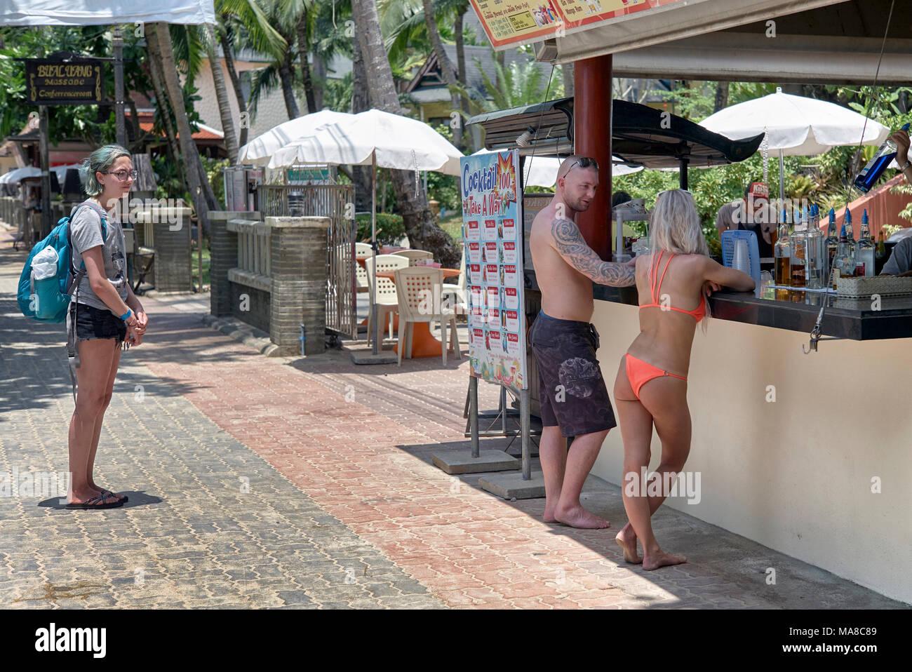 Thailand Tourists at a beach side cocktail bar. Ao Nang Krabi Thailand - Stock Image