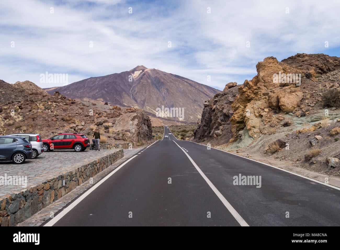 TF21 road on the green rocks of Los Azulejos towards the Teide volcano in Tenerife, Spain - Stock Image