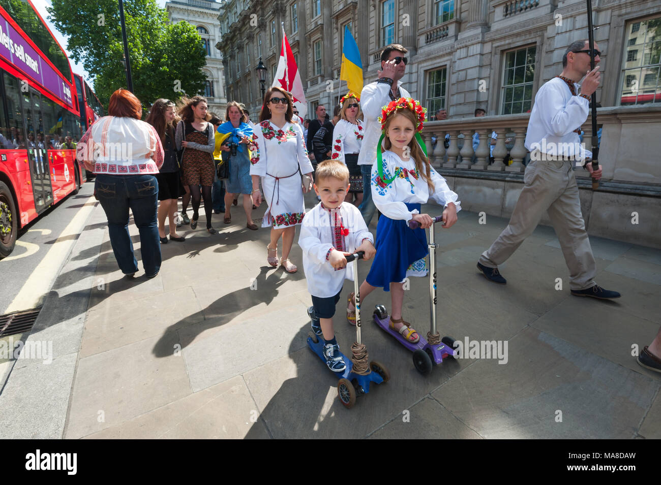 Children on scooters on the Vyshyvanka Embroidery march in