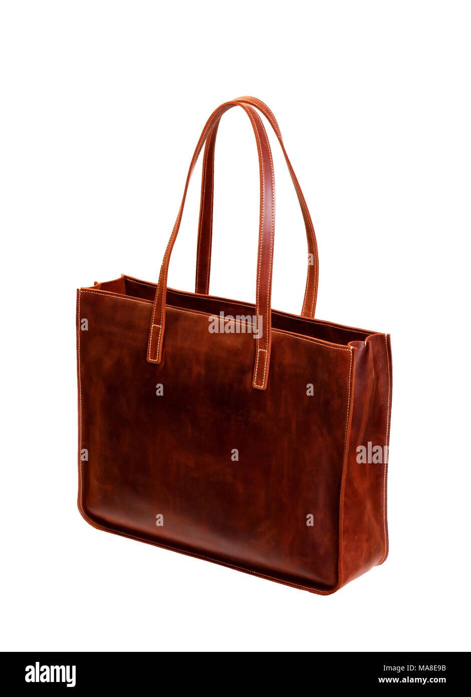 A leathern handbag on a white background - Stock Image