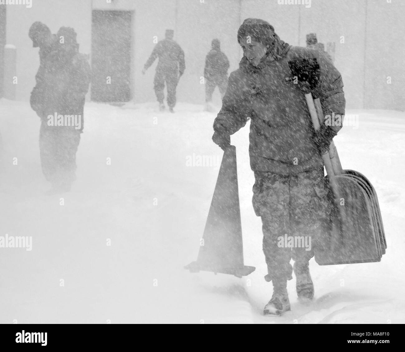 A New York Army National Guard Soldier from the 42nd Combat Aviation Brigade based in Latham, New York prepares for missions as a massive snow storm hits New York, March 14, 2017. () Stock Photo