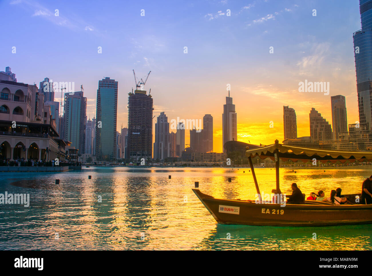 Dubai Fountain Lake Ride, dancing fountain show next to the Dubai Mall and Burj Khalifa - Stock Image