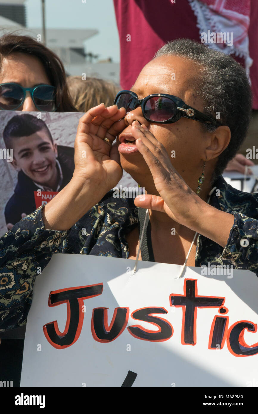 A woman shouts for justice for Jimmy Mubenga at the at Stop G4S protest outside G4S AGM at Excel London. Stock Photo