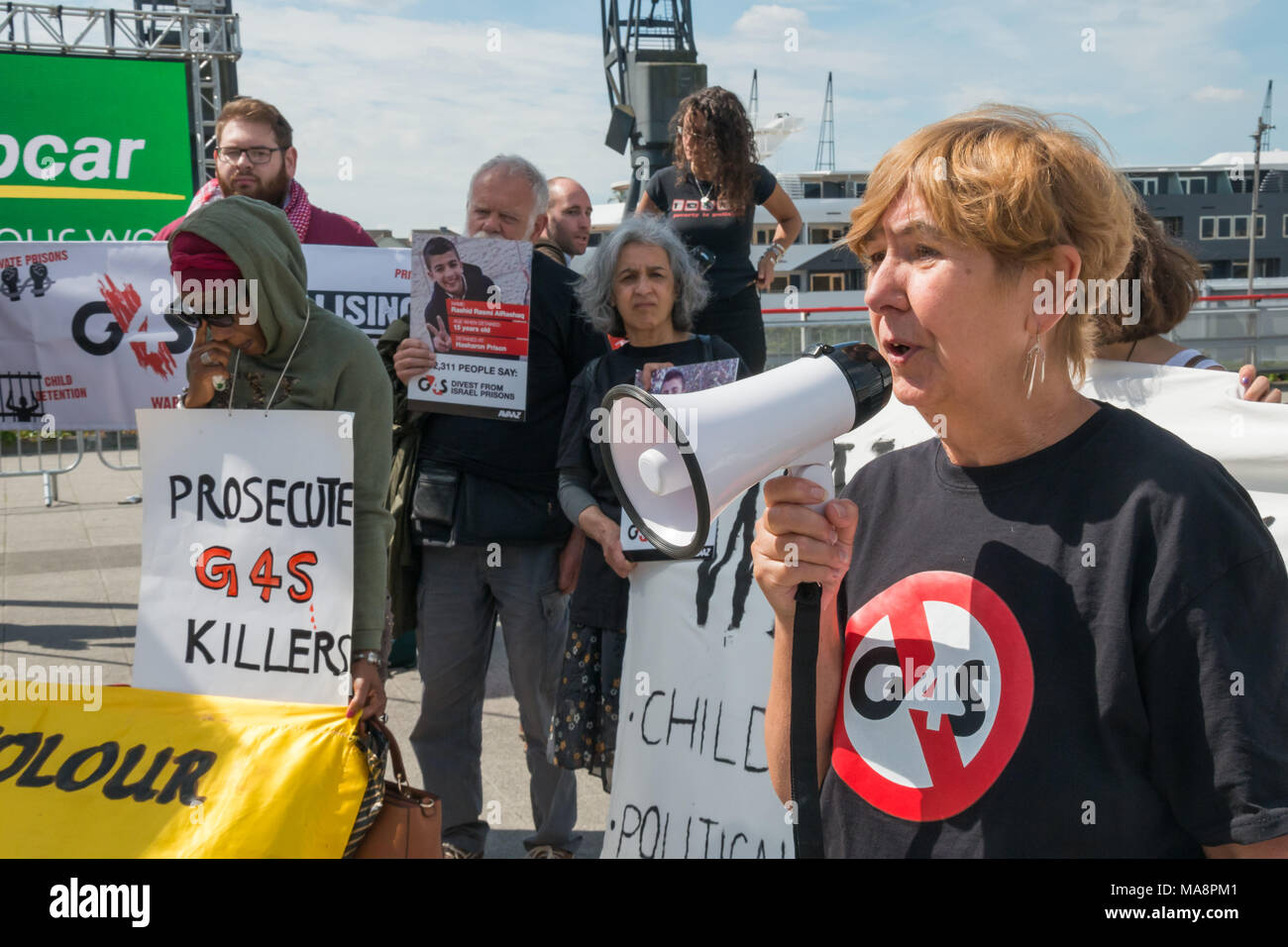 A protester speaks about the homeless protests in Manchester, where g4S have been refusing to allow the homeless to enter the public Library where they provide securty at Stop G4S protest outside G4S AGM at Excel London. Stock Photo