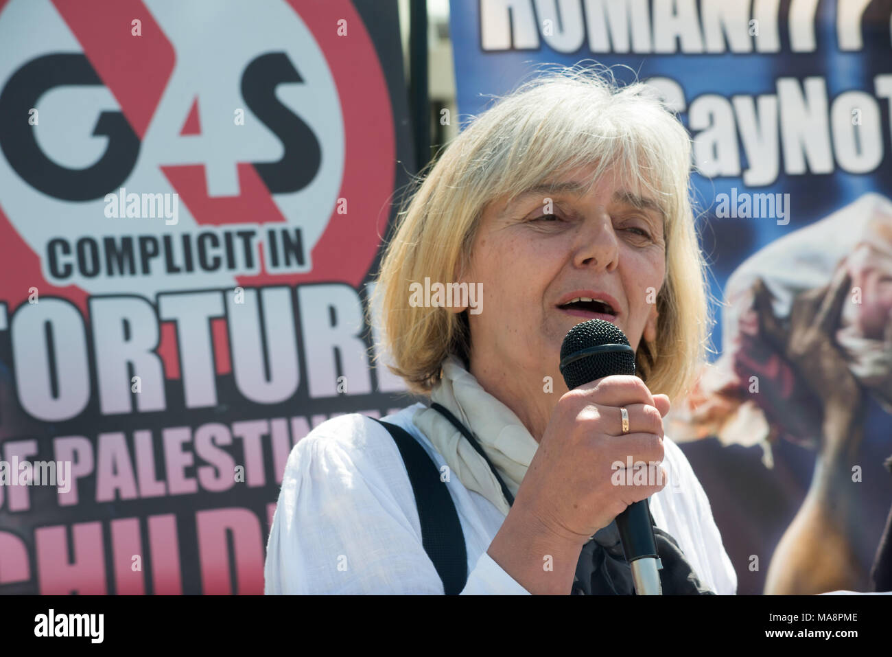 A G4S shareholder who is protesting at Stop G4S protest tells those outside the building how she was ejected from the meeting after raising the question of the treatment of the Hares boys, held for over two years for an imaginary offece.. Stock Photo