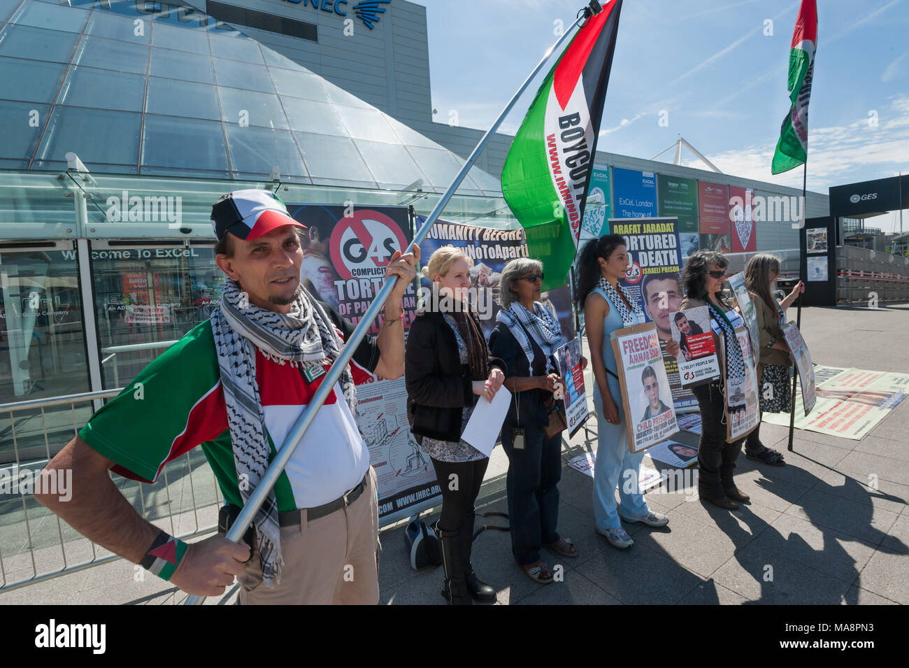 Inminds portesters prepare to give a presentaiont at Stop 4S protest outside G4S AGM at Excel London. Stock Photo