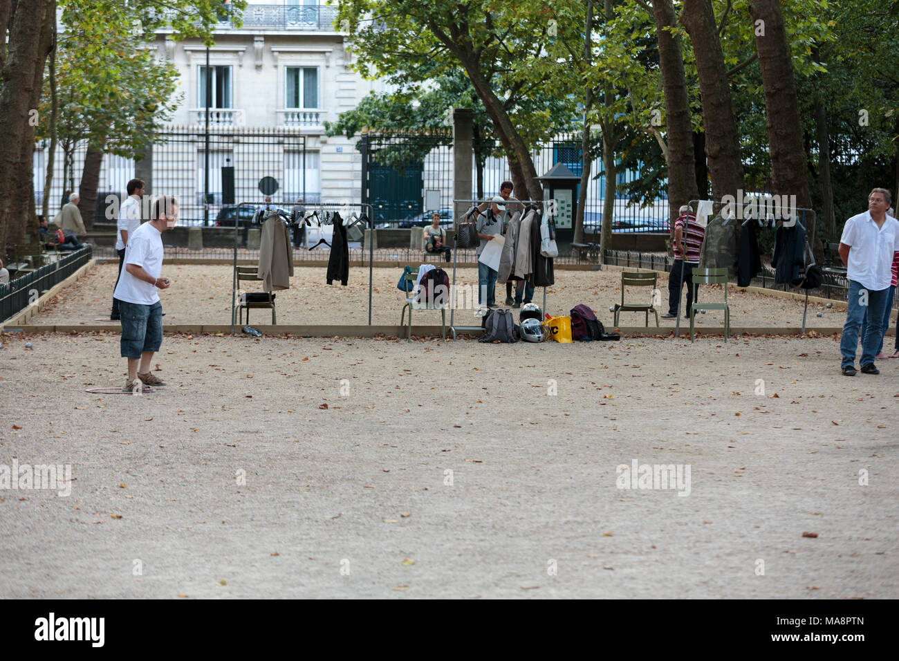 Playing petanque in the late afternoon in Luxemburg Garden in Paris, France - Stock Image