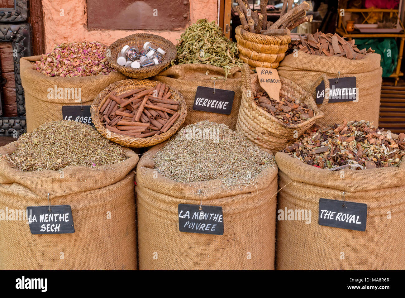 MOROCCO MARRAKECH PLACE JEMAA EL FNA MEDINA AND SOUK  SHOPS AND STALLS SPICES IN SACKS WITH LABELS - Stock Image