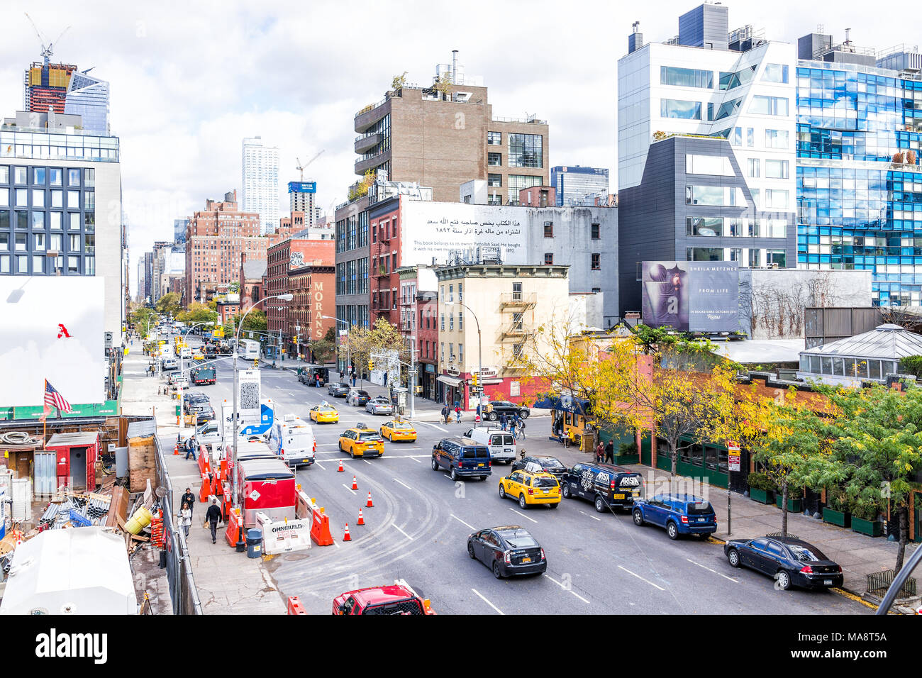 New York City, USA - October 30, 2017: Aerial view of modern Chelsea neighborhood construction buildings, parking and cars traffic on street below in  Stock Photo