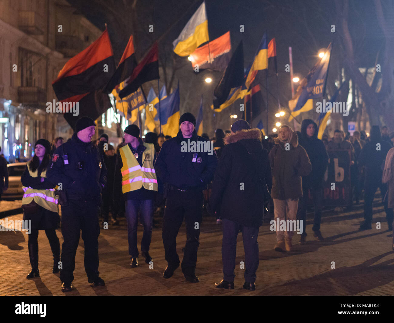 ODESSA, UKRAINE - January 30, 2018: People demonstrating civil peaceful protest during a state of armed revolution Ukraine. Movement of column of demonstrators at rally on the streets - Stock Image