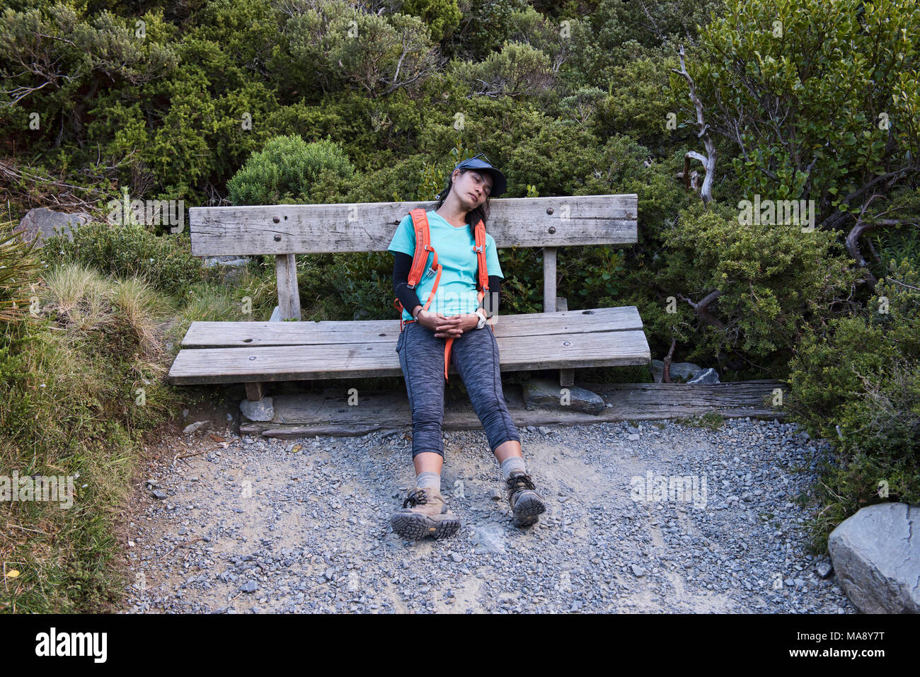 Exhausted trekker, Mueller Hut Track, Southern Alps, New Zealand - Stock Image