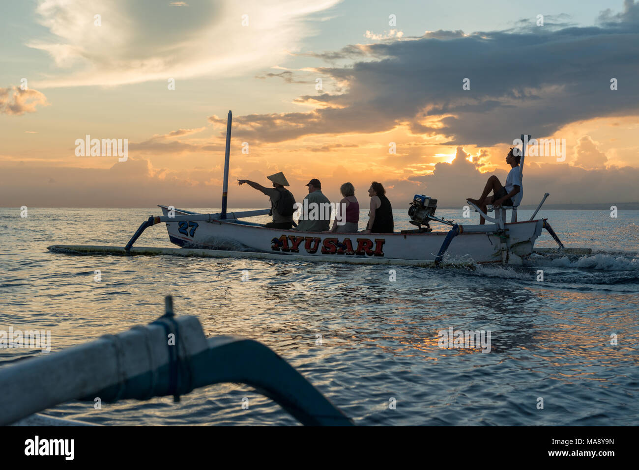 Tourists go on a dolphin watching tour - Stock Image
