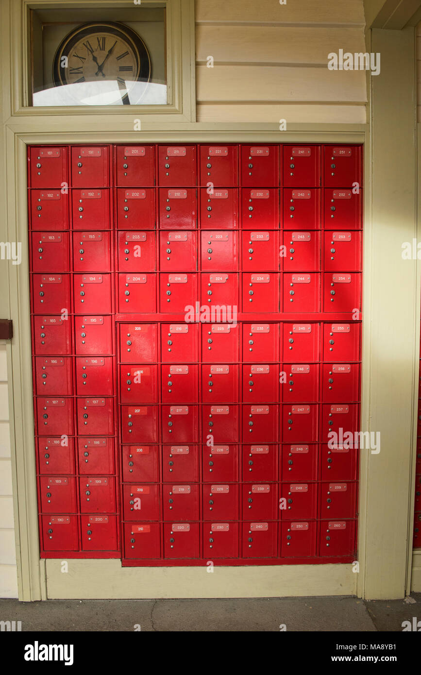 Colorful mailboxes in the post office in historic Arrowton, Otago, New Zealand Stock Photo
