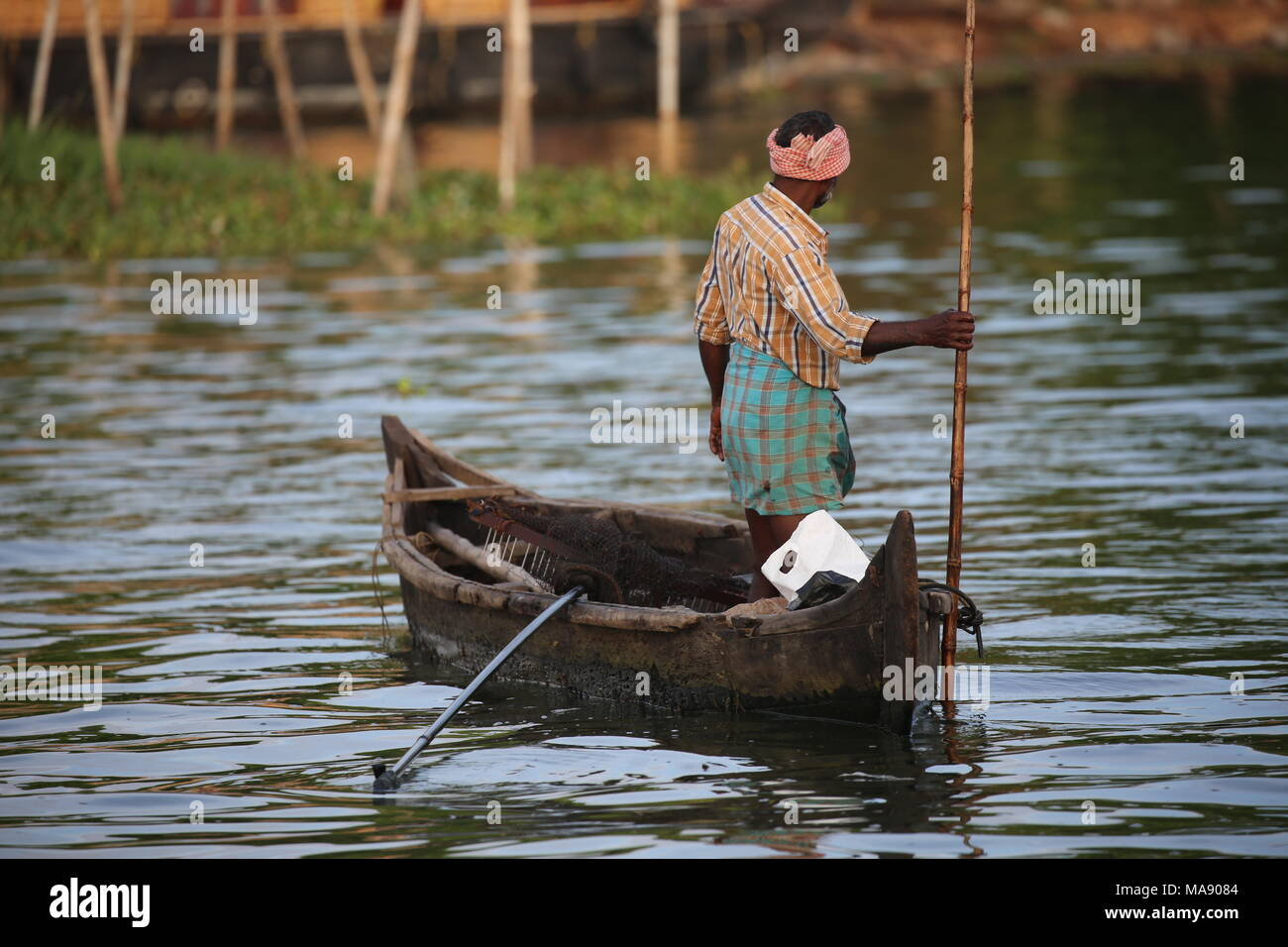 Man with a smal boat was fishing in Kerala Backwaters - Alter Mann in einem Boot beim fischen in kerala - South India - Stock Image
