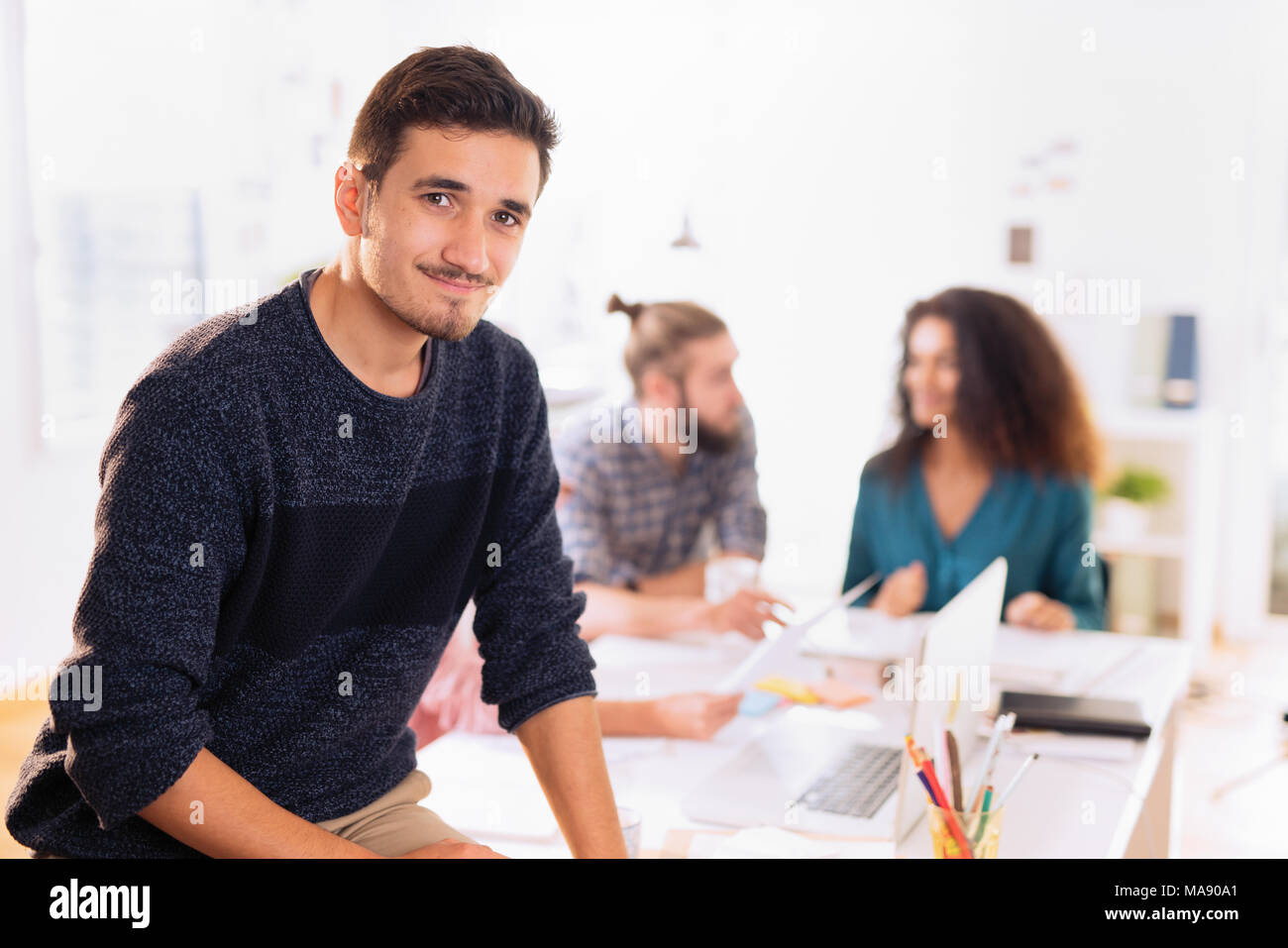 At the office. Portrait of a young man looking at the camera - Stock Image