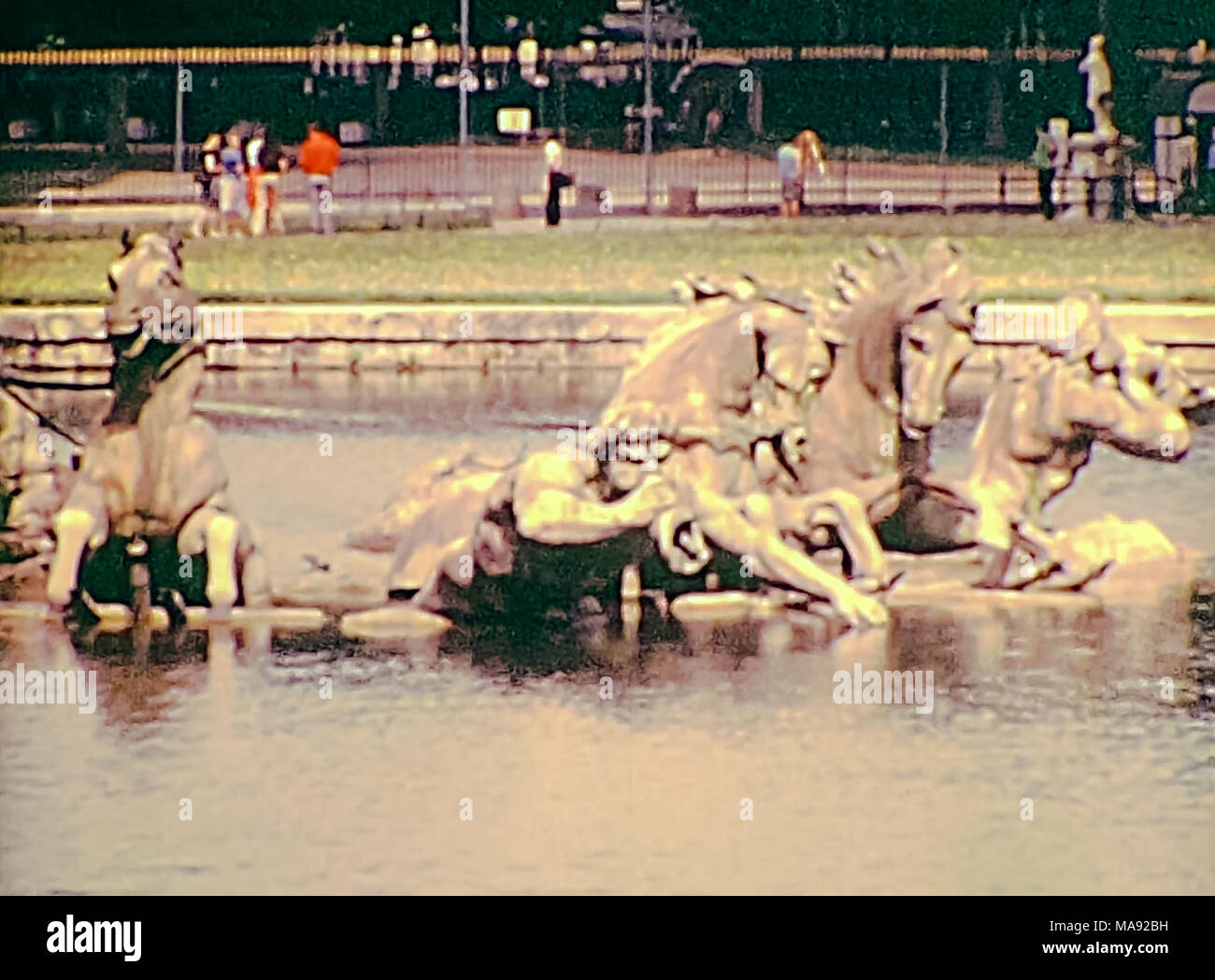 Statues of the Quadriga in the Apollo fountain at Palace of Versailles garden in 1976. Historic archival footage in Paris city of France from 1970s. - Stock Image