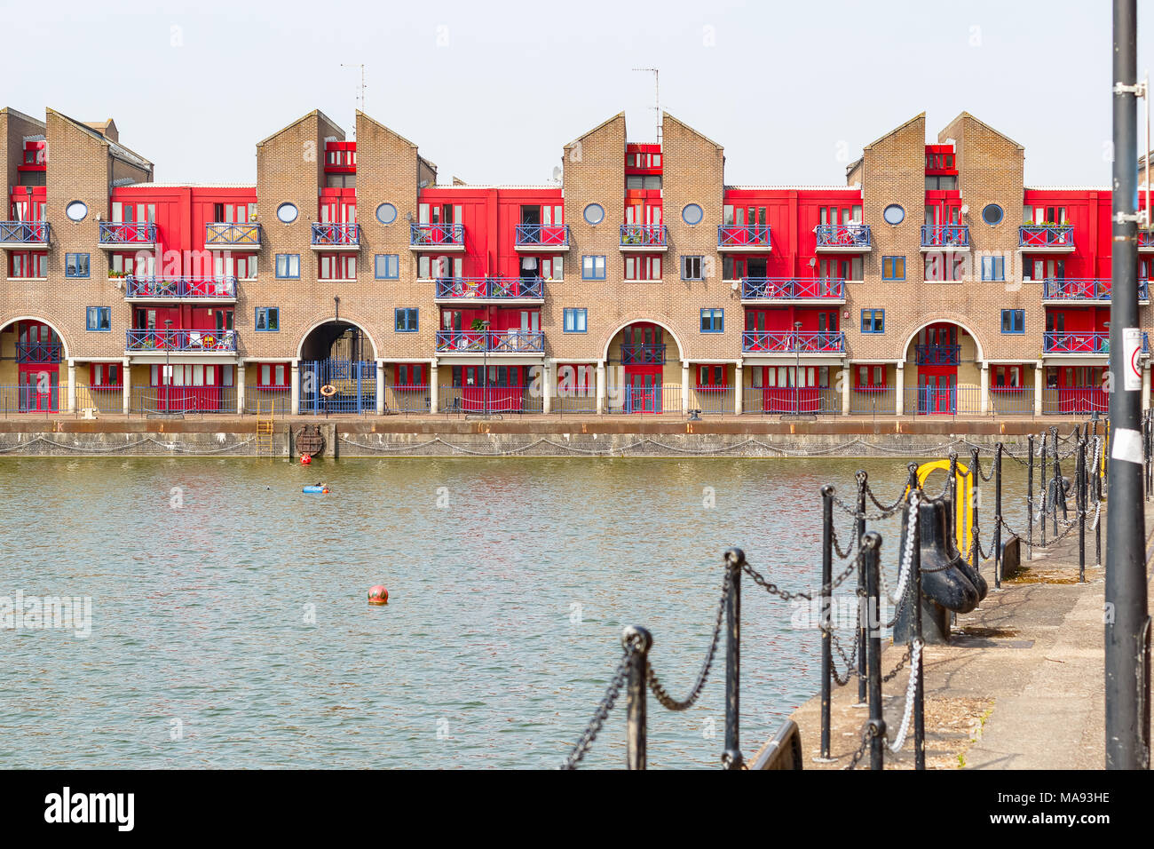 Dockside apartments at Shadwell Basin, part of London Docks in London - Stock Image
