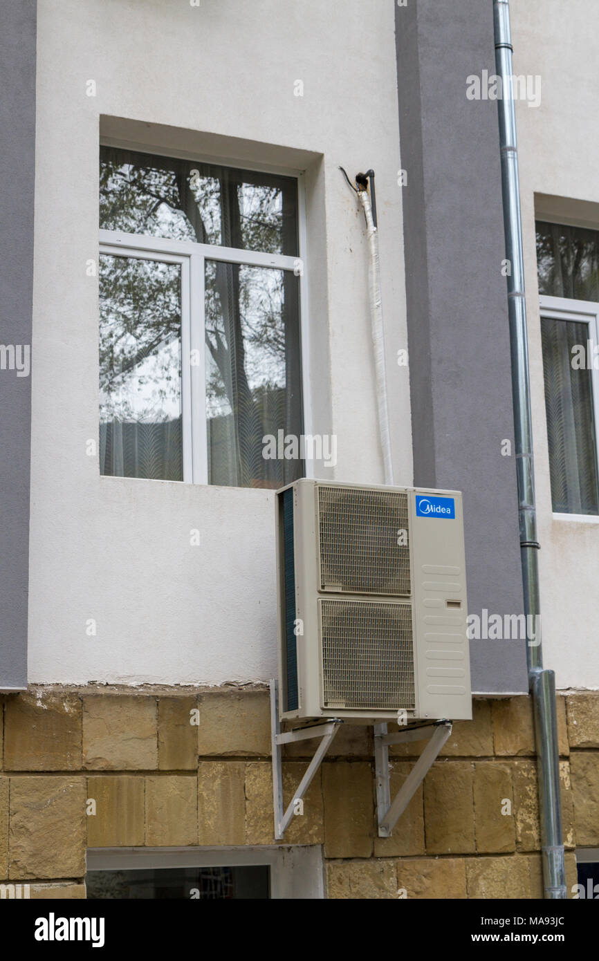 A Midea air conditioning unit on the outer wall of a ...