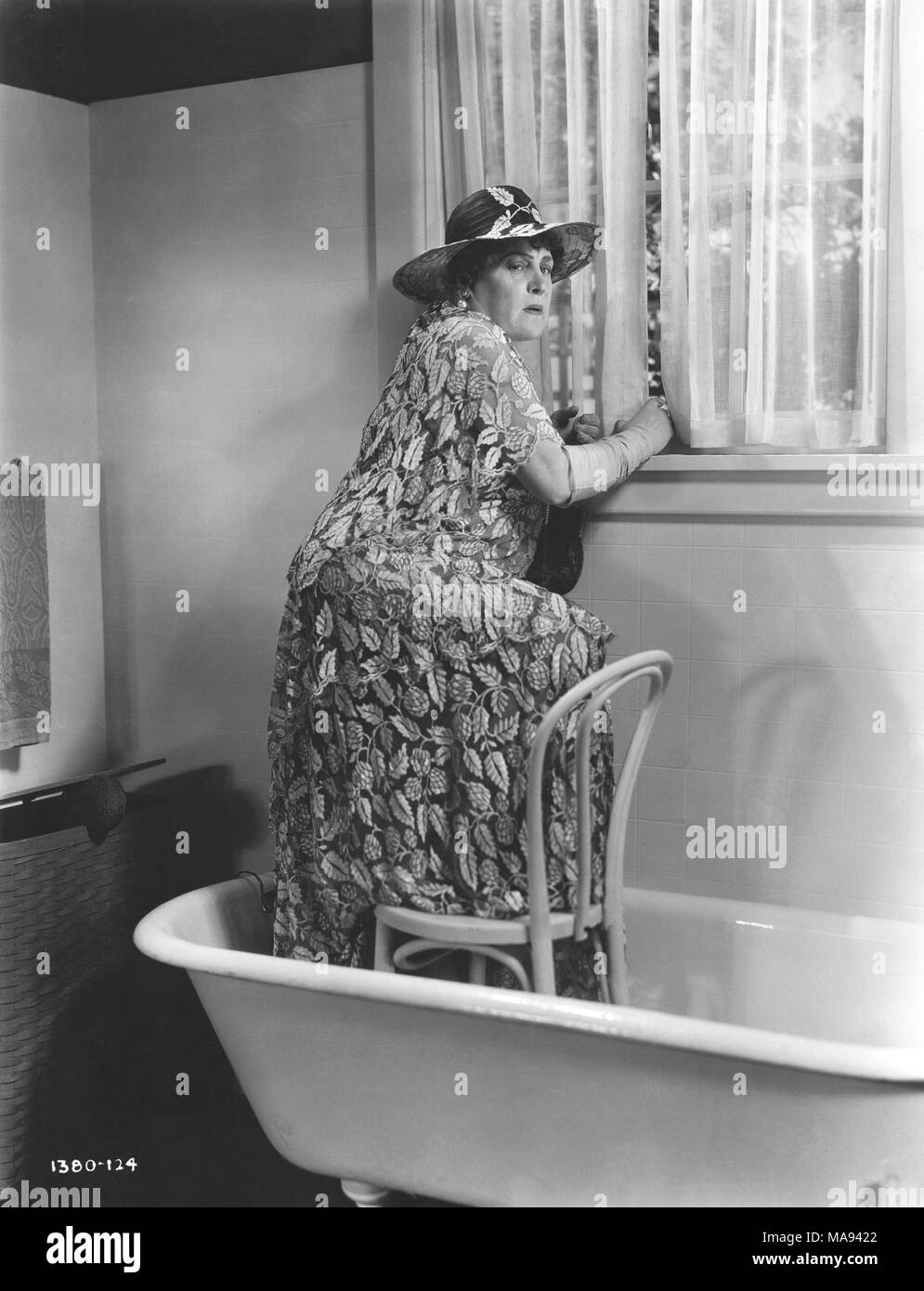 Alison Skipworth, Publicity Portrait Standing in Bathtub on-set of the Film, 'Madame Racketeer', Paramount Pictures, 1932 - Stock Image