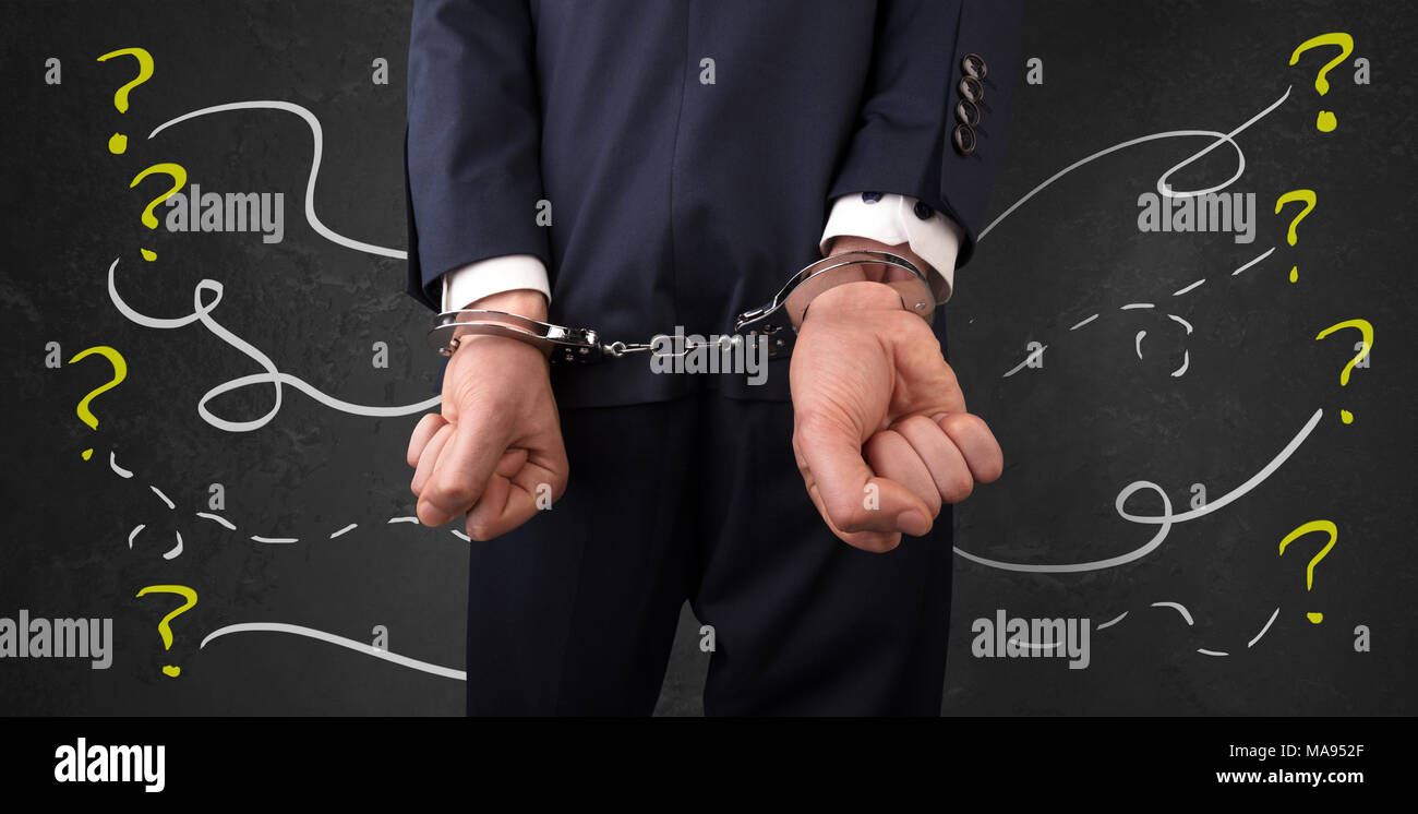 Now arrested men with handcuffs and chalk drawn question signs and lines around  - Stock Image