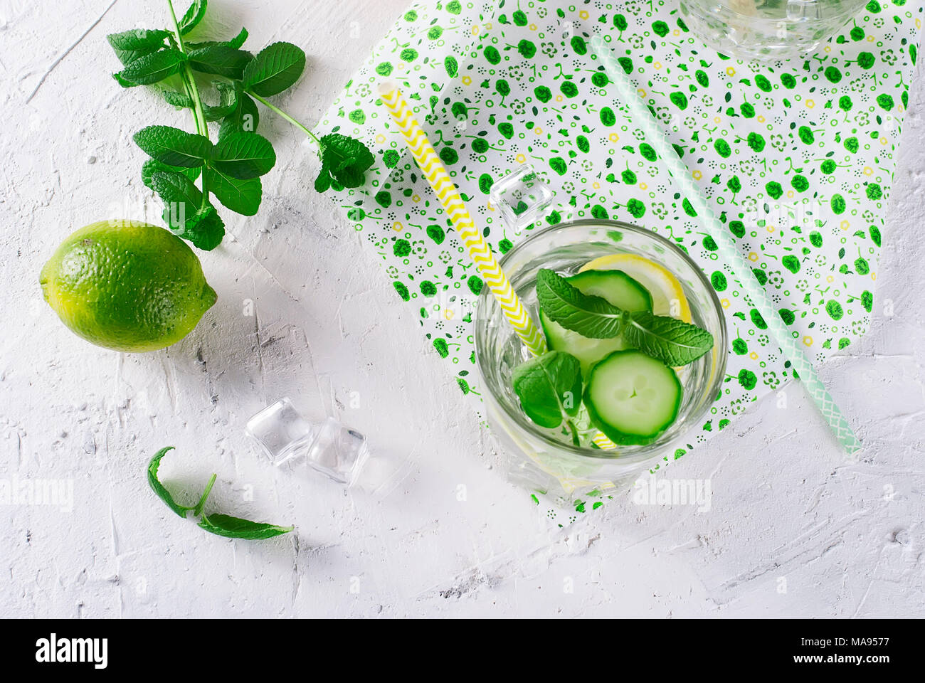 Refreshing cucumber cocktail, lemonade, detox water in a glasses on a white background. Summer drink. Top view - Stock Image
