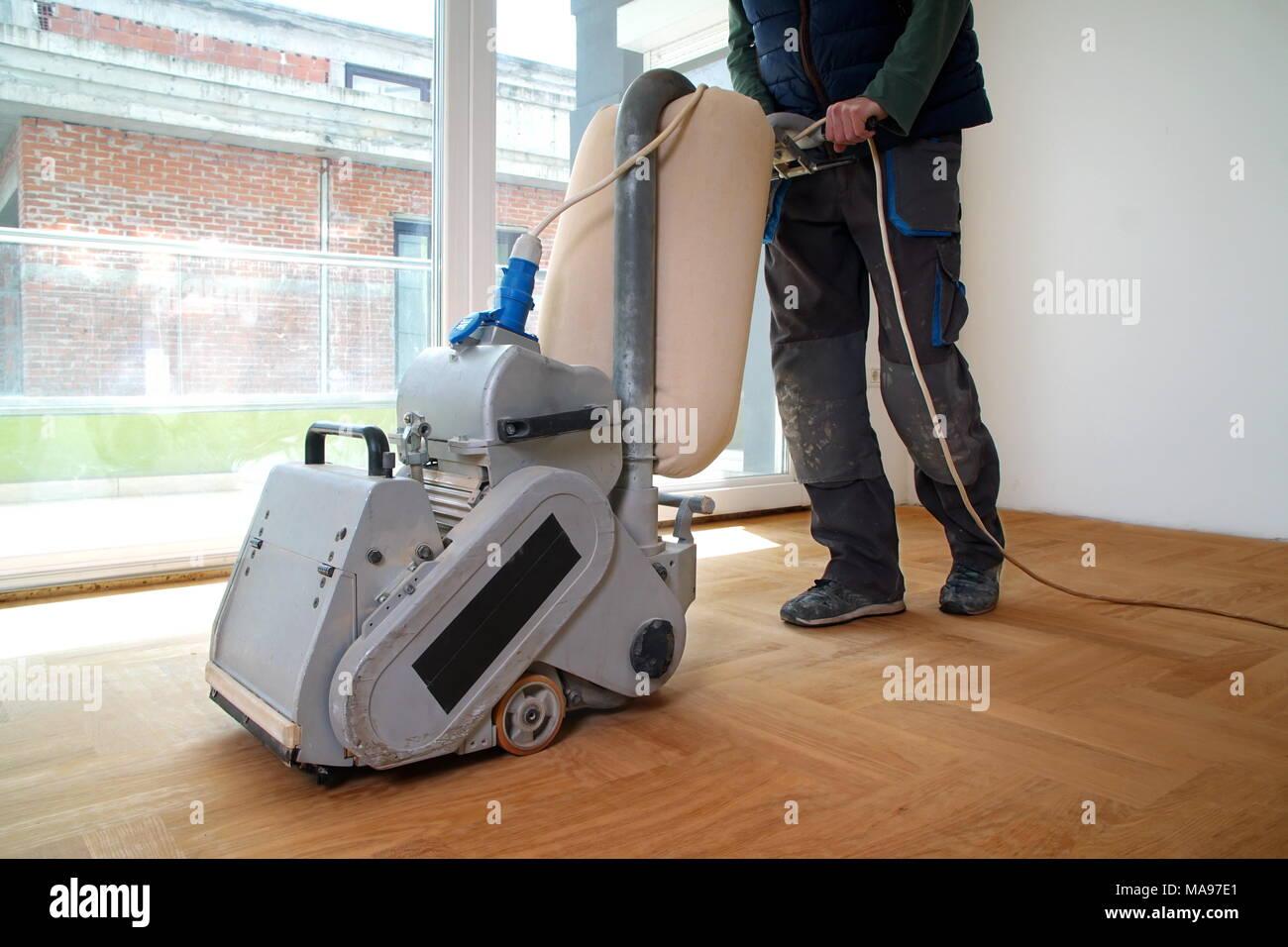 Sanding Hardwood Floor With The Grinding Machine Repair In The