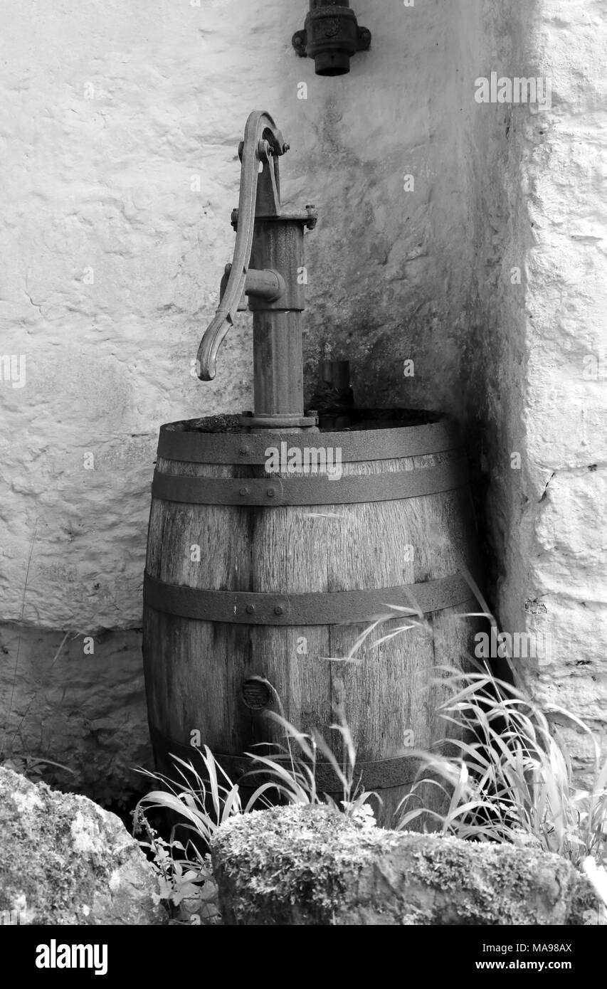 Monochrome image of an old cast-iron hand water pump
