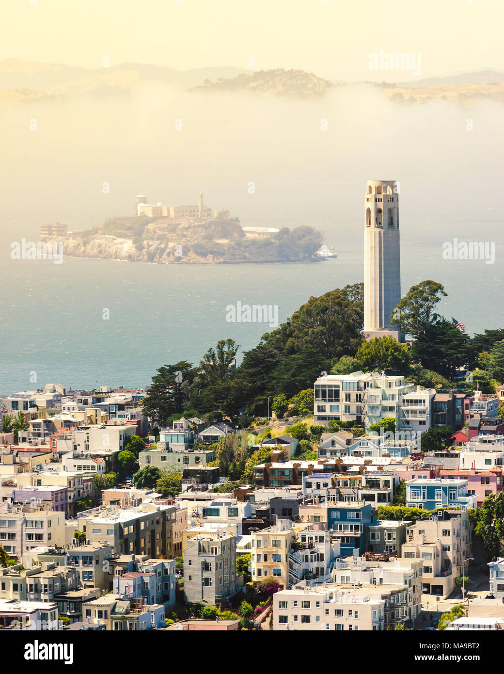 Golden hour sunset with Coit Tower, Alcatraz and classic San Francisco houses in North Beach. - Stock Image