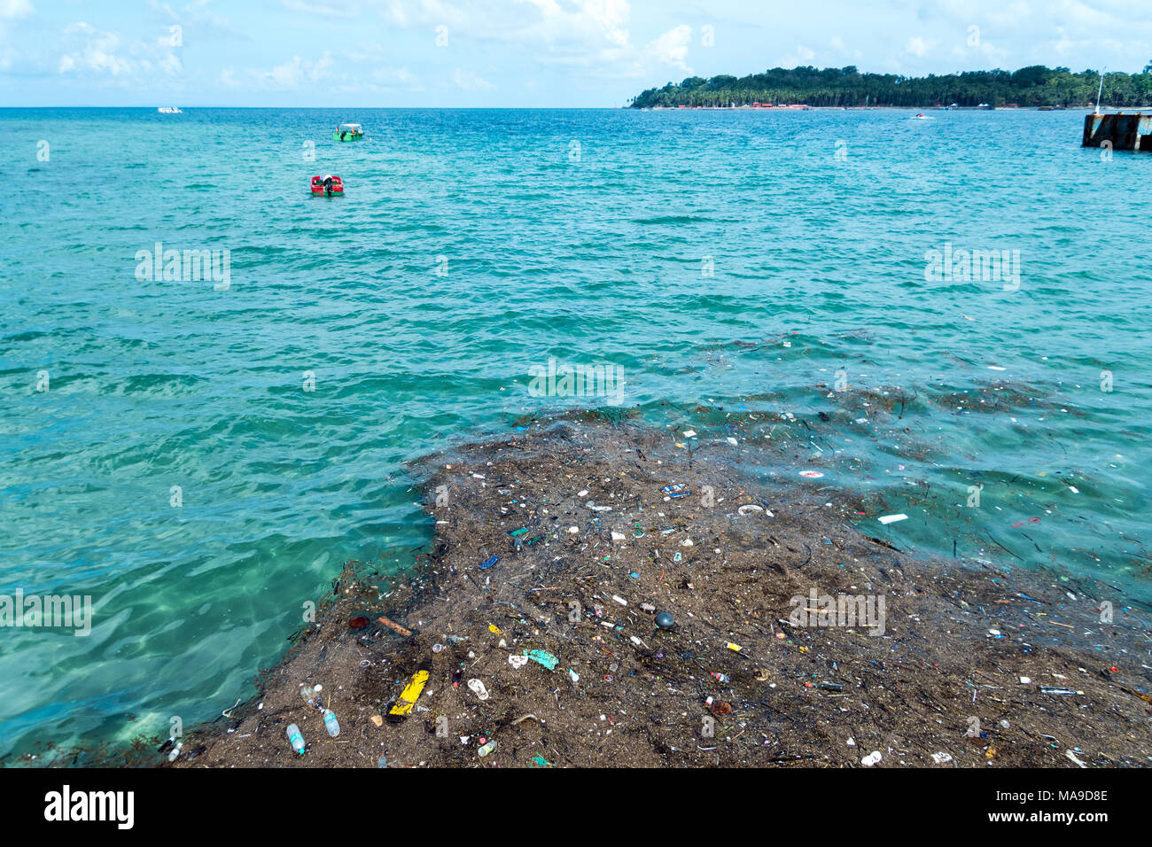 Plastic rubbish pollution in ocean. Photo showing pollution problem of garbage thrown directly into the sea with no proper trash collection or recycli - Stock Image