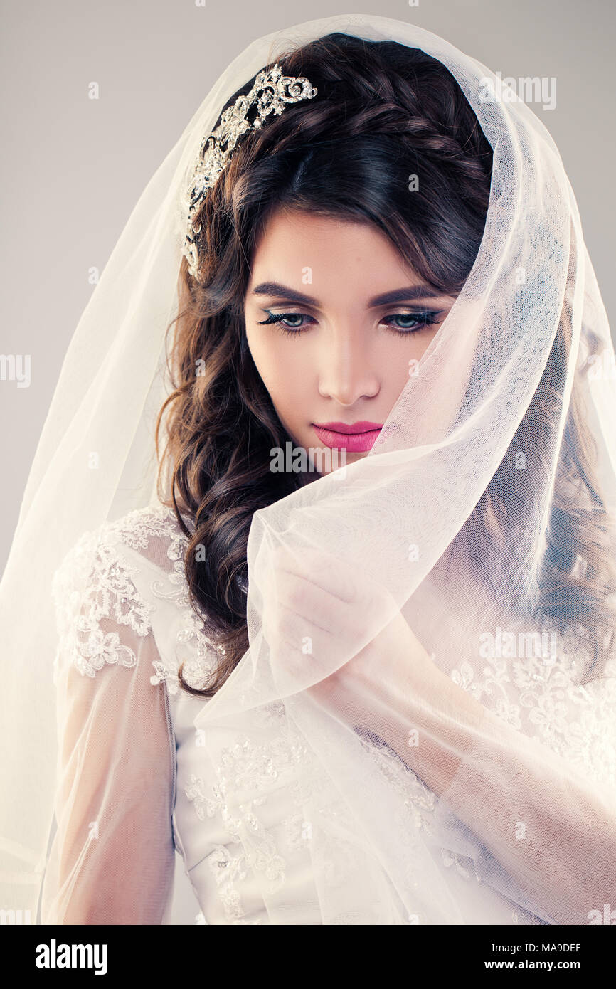 Gorgeous Bride with Fashion Makeup and Wedding Hairstyle in a ...