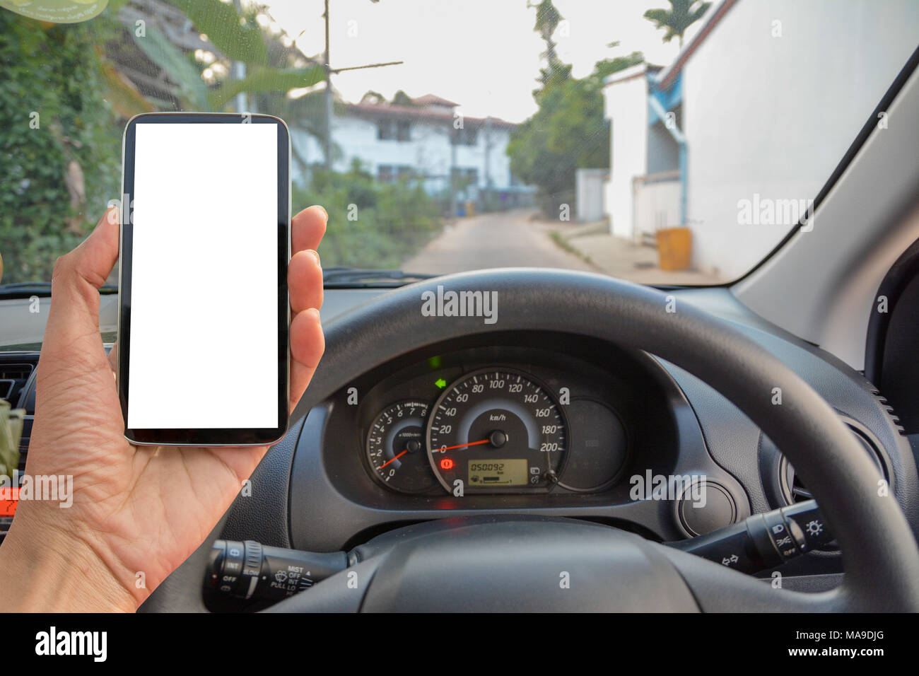 car and smart phone , using navigation app on smart phone. - Stock Image