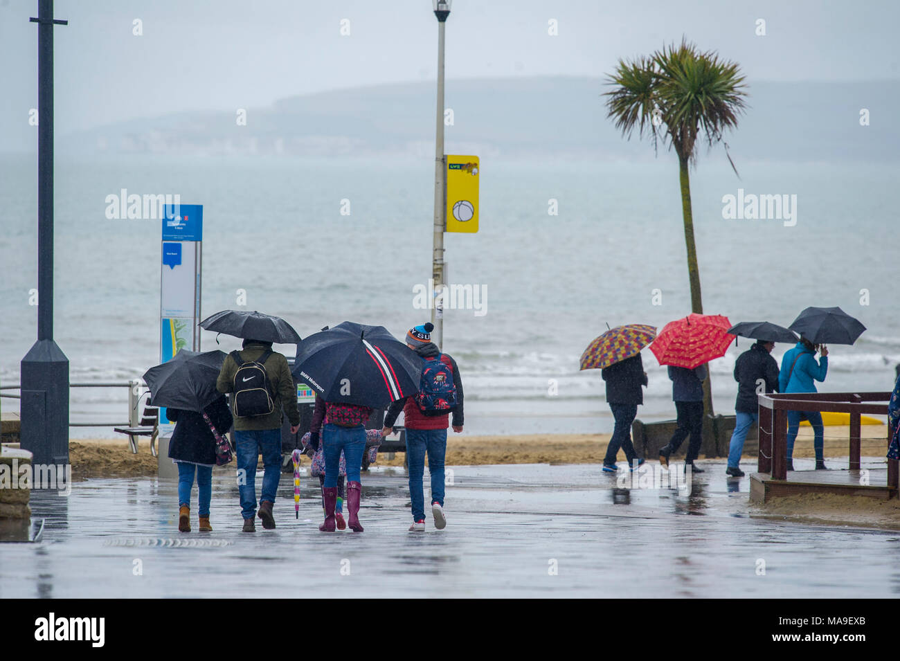 Bournemouth, UK, 30 March 2018. A wet start to the Easter Weekend at Bournemouth beach as rain continues on the South Coast of Englandon Good Friday. Credit John Beasley/Alamy Live News - Stock Image