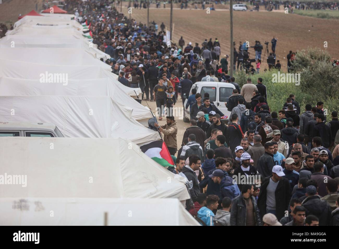 (180331) -- GAZA, March 31, 2018 (Xinhua) -- Palestinians take part in a protest along the Israel border with Gaza, demanding the right to return to their homeland, on the 42nd Anniversary of the Palestinian Land Day, in Gaza City, on March 30, 2018. (Xinhua/Wissam Nassar) - Stock Image